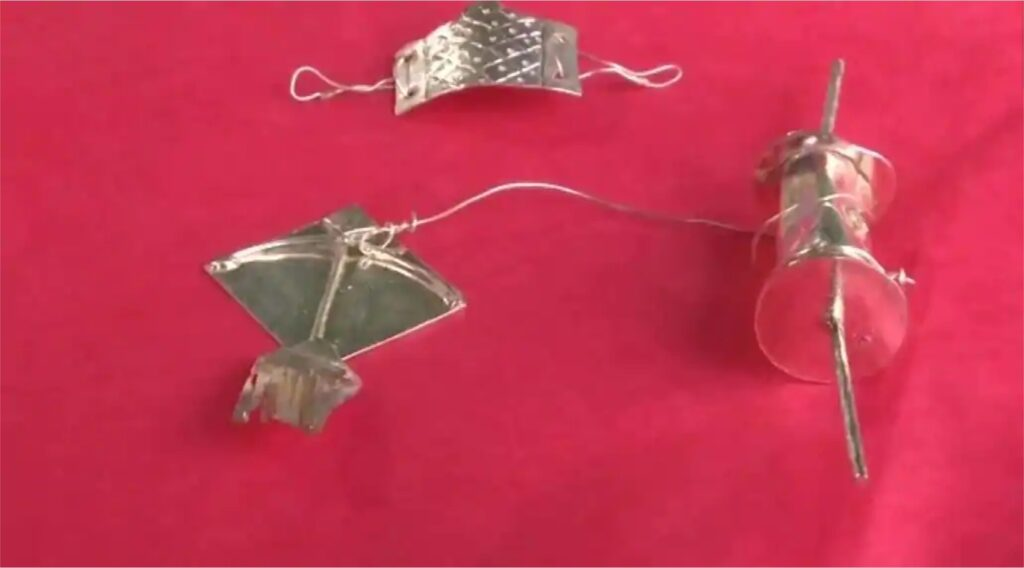 Hyderabad Artisan Crafts Miniature Versions of Kite and Face Mask with Gold, Silver